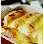 Schinken-Sauerkrautrollen – Sauerkraut and Ham Rolls over Cheesy Potatoes